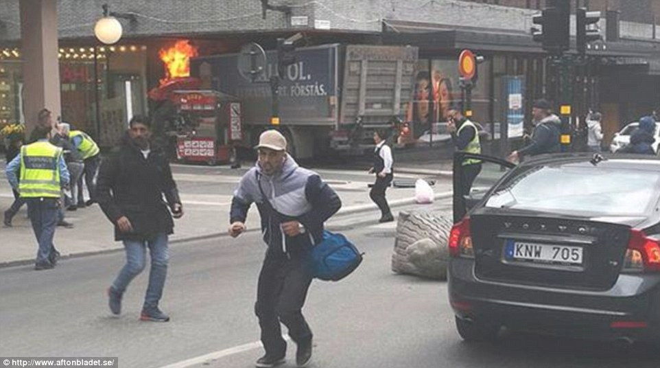 3F0B830100000578-4390436-People_were_seen_running_after_a_truck_crashed_into_the_mall_ear-a-57_1491574312404(1)