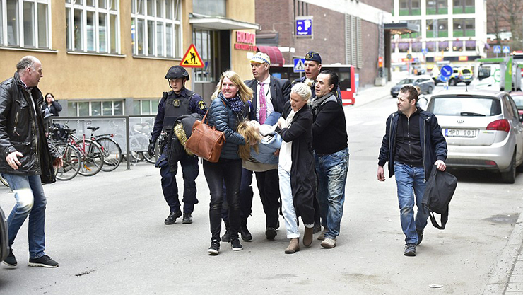 3F0BC19600000578-4390436-An_injured_person_was_seen_being_carried_from_the_scene_by_a_gro-a-50_1491574312132