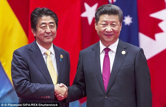 4EE471AD00000578-0-In_2014_a_photographed_handshake_between_President_Xi_and_Japane-a-16_1533632927581