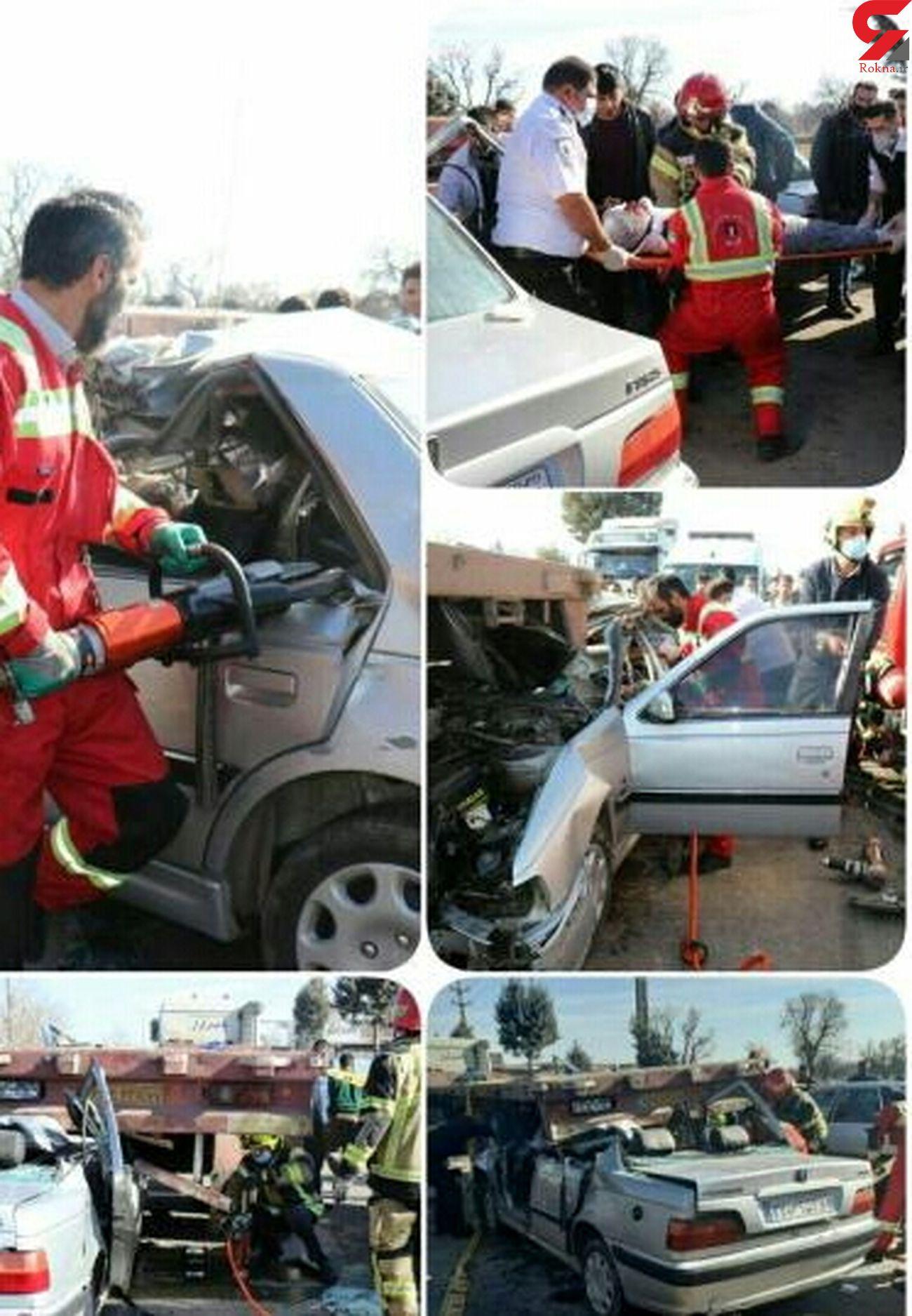 5 عکس از کنده شدن سقف پژو زیر تریلی / راننده در قزوین کشته شد