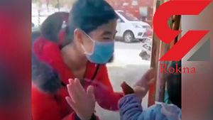 صحنه احساسی ملاقات یک پرستار قرنطینه کرونا با فرزندش پس از 26 روز + فیلم / چین