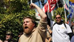 راهپیمایی مخالفان و موافقان کنترل سلاح در سیاتل/ تلاش پلیس ضدشورش آمریکا برای جدا نگه داشتن معترضان+ تصاویر