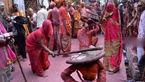 زنان هندی در این جشنواره با چوب به جان شوهران شان می افتند+تصاویر