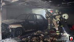 آتش سوزی خودروی سواری در پارکینگ ساختمان مسکونی + عکس