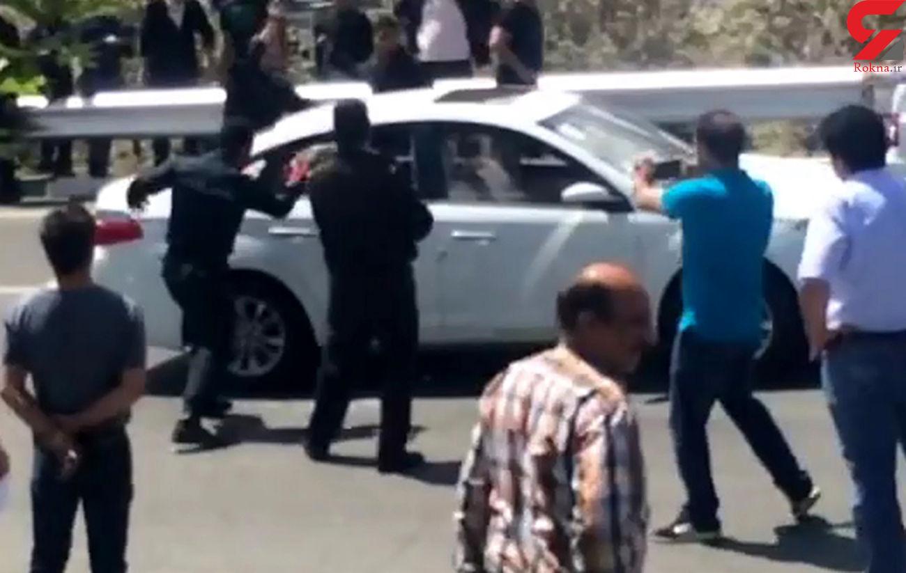 دزد قمه به دست اتوبان باکری تهران را بست / شلیک پلیس ماجرای گروگانگیری زن و مرد را پایان داد + فیلم و صدا