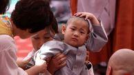 مراسم سنتی تراشیدن موی سر کودکان در کره جنوبی+عکس