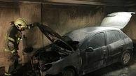 آتش سوزی خودرو در پارکینگ ساختمان 5 طبقه در پاسداران +عکس