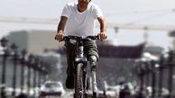 دوچرخه سواری جوان ایرانی با یک پای آهنی + عکس