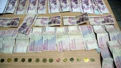 دستگیری عاملان خرید و فروش چک های تقلبی +عکس