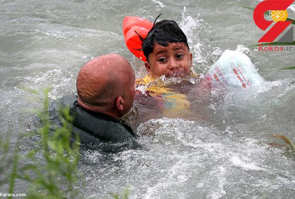 لحظه نجات کودک مهاجر از رودخانه مرگ+عکس